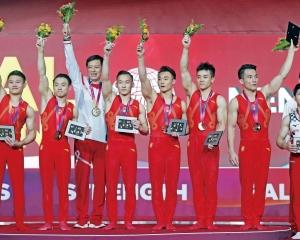 中國男團贏得險