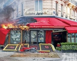 巴黎名店遭打砸焚燬 警拘近240人