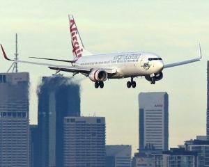澳洲兩客機險空中相撞
